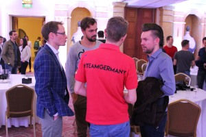 WSOP Player of the Year George Danzer speaks with fellow Team Germany member Ole Schemion and Christopher Frank along with Team Pro Jan Heitmann